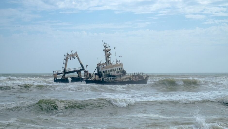 A ruined ship amid crashing waves