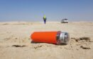 A seismic node on the sand in the desert