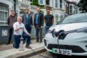 Trojan Energy CEO Ian Mackenzie and team members next to a charging point.