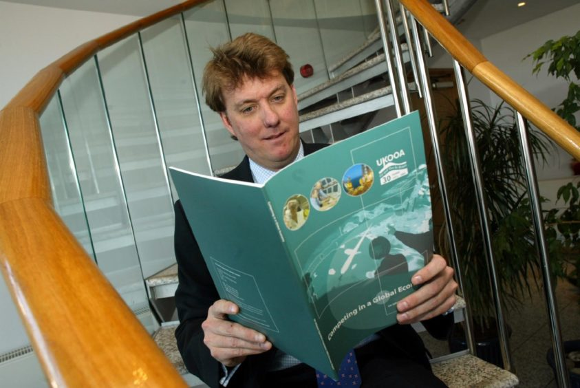 Bruce Dingwall photographed in 2003 holding a report by the UK Offshore Operators Association, of which he was president.