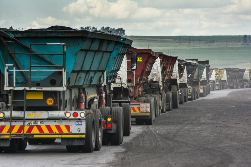 Coal delivery trucks queue at a weighbridge at the Goedehoop coal mine, operated by Anglo American Plc, in Mpumalanga, South Africa, on Tuesday, Jan. 12, 2021. In South Africa, for decades almost all the electricity needed to power Africa's most industrialized economy has been produced by a fleet of aging coal-fired plants constructed alongside the mines to the east of Johannesburg. Photographer: Waldo Swiegers/Bloomberg