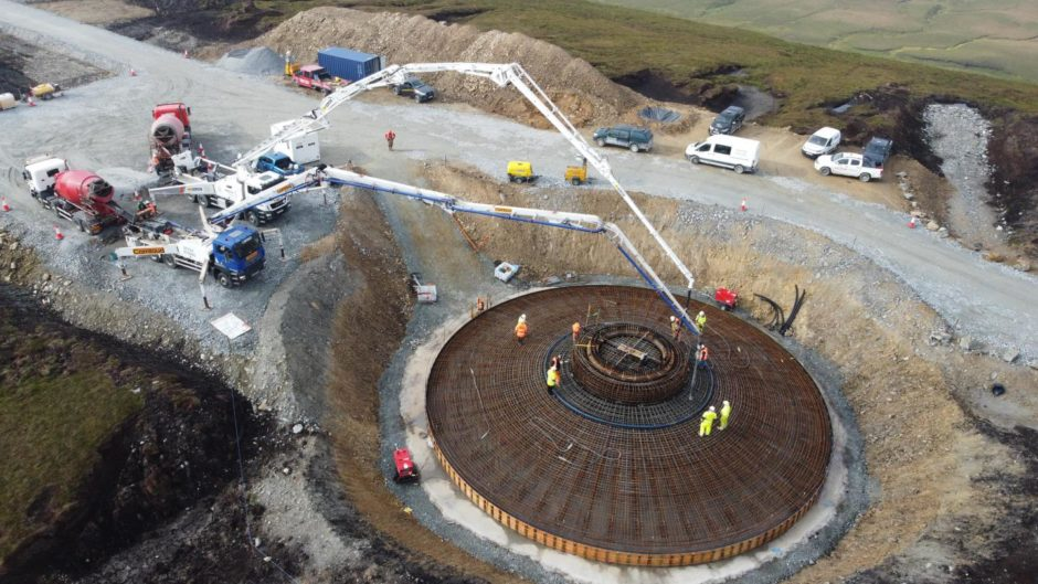 Concrete being poured into the first of 103 turbine foundations
