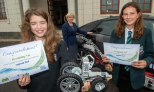 The two Cults Academy winning pupils with their winning design and Aberdeen City Council Leader Councillor Jenny Laing (centre)