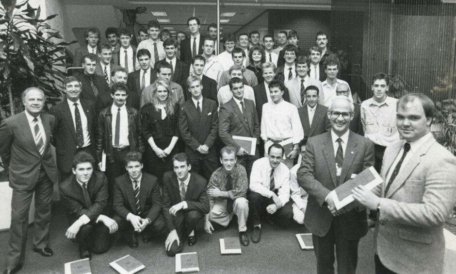 """Shell 1988-09-14 Graduation Ceremony (C)AJL  14 September 1988  """"Fifty successful students from throughout Scotland and as far south as Norfolk look on as Shell Expro director of operations Mr Ian Henderson presents Kevin Barrie, Macduff, with his Shell Expro Technician Scheme graduation certificate, at a ceremony in the Shell offices, Tullos, Aberdeen, yesterday.""""  Used: P&J 15/09/1988"""
