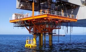An orange oil platform in the sea