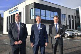 Cabinet secretary for net zero and energy cuts ribbon on Moray East O&M base