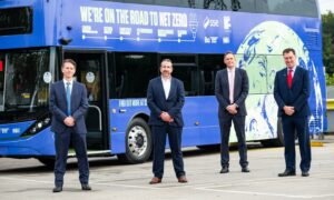 Left to right, David Brown, Chief Executive, Go-Ahead Group, Nathan Sanders, Managing Director of SSE Distributed Energy, Paul Davies, President and Managing Director of Alexander Dennis (ADL) and Frank Thorpe Managing Director of BYD UK standing in front of the Road to Renewables Bus which will travel from London to Glasgow arriving ahead of COP26. Northumberland Park Bus Depot, London. Supplied by SSE Date; 18/10/2021