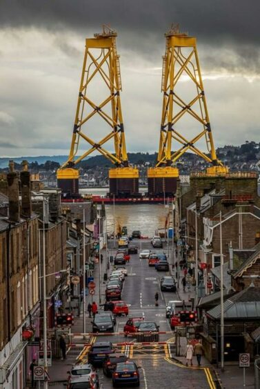 A barge shipping turbine jacket foundations for installation at the Seagreen Wind Farm passes Broughty Ferry on Saturday. The bases were brought to Port of Dundee whilst the barge was readied for offshore installation