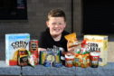 Ross with some of the donations. Picture by Kenny Elrick