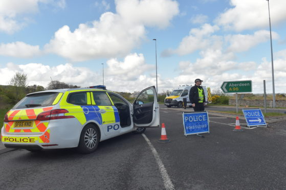 Police at the scene on the A96