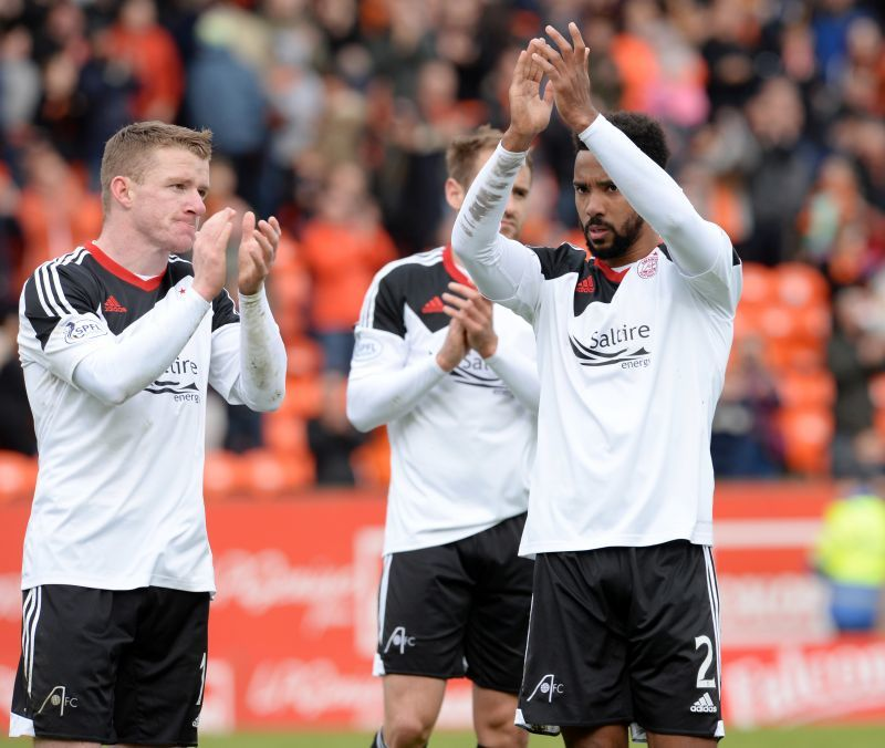 Aberdeen's Shay Logan applauds the travelling support at full time