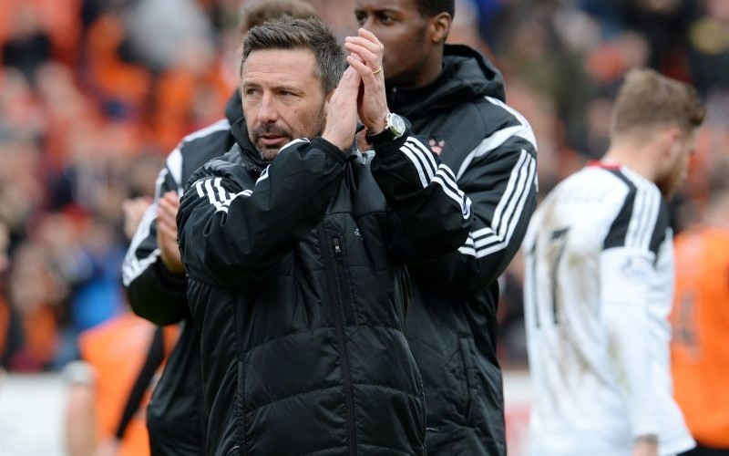 Aberdeen manager Derek McInnes applauds the travelling support at full time