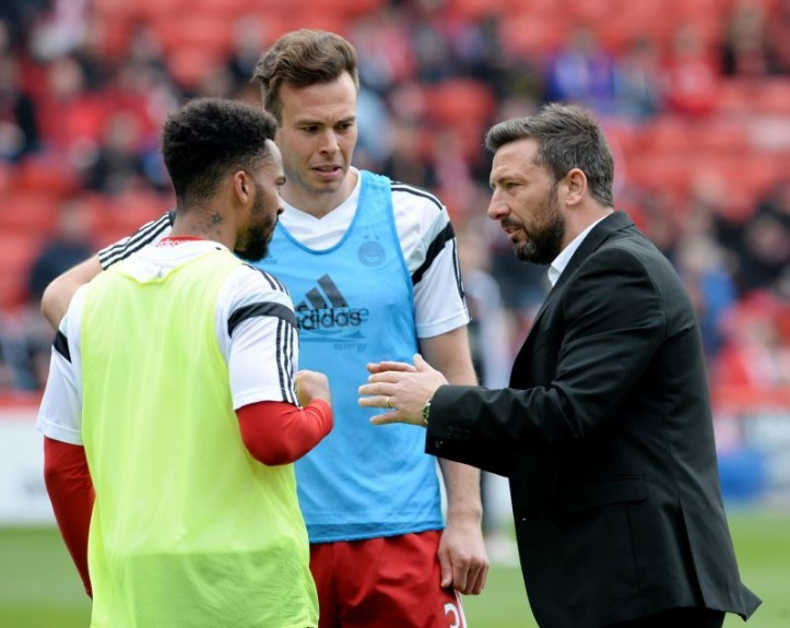 Aberdeen manager Derek McInnes chats to defensive duo Shay Logan (left) and Andrew Considine (centre)