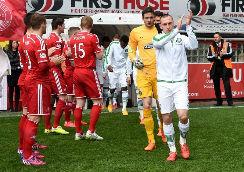 The Aberdeen players form a guard of honour in tribute to league champions Celtic