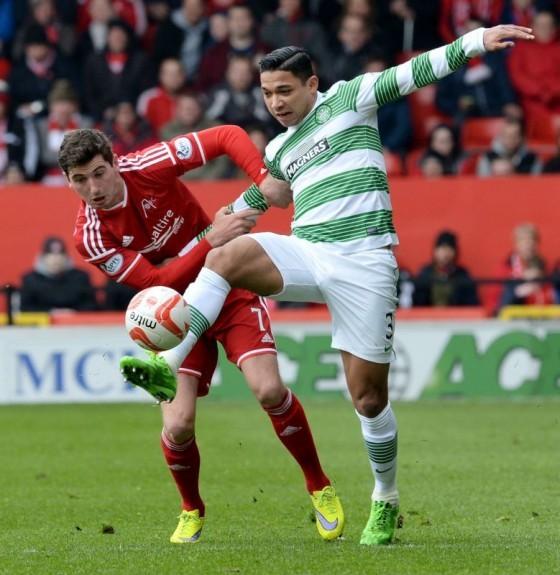 Celtic's Emilio Izaguirre battles it out with Kenny McLean (left)