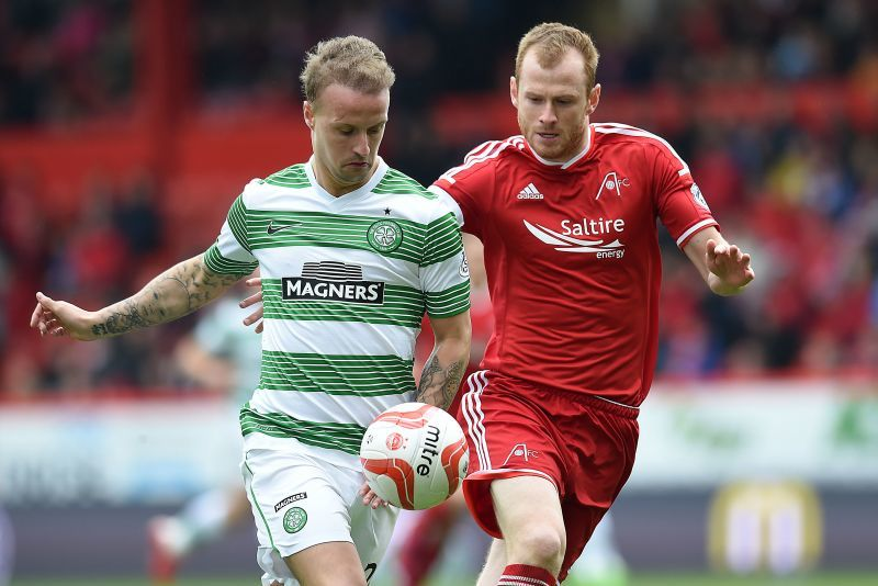 Aberdeen's Mark Reynolds keep the pressure on Leigh Griffiths (left)