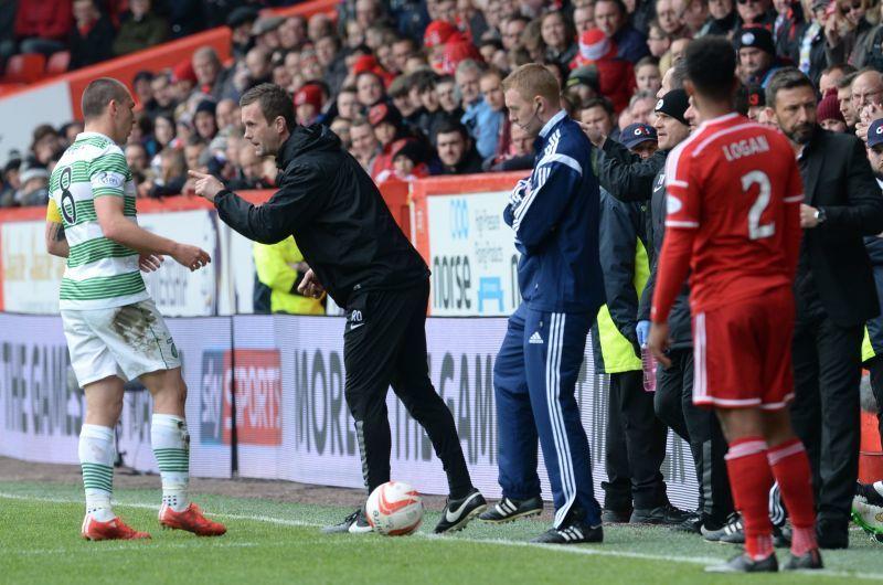 Celtic manager Ronny Deila gets instructions out via his captain Scott Brown (left)