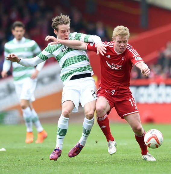 Barry Robson (right) does well to hold off Celtic's Stefan Johansen
