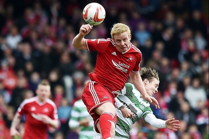 Barry Robson (top) gets the better of Celtic's Stefan Johansen in the air