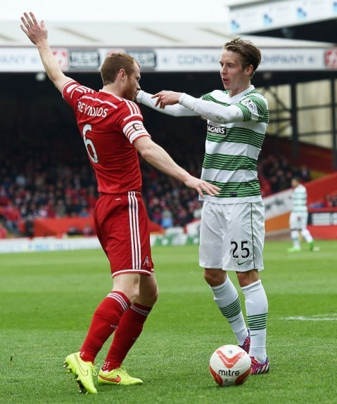 Celtic midfielder Stefan Johansen gets pushy with Mark Reynolds (left)