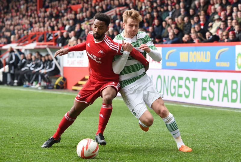 Aberdeen defender Shay Logan goes up against Stuart Armstrong (right)