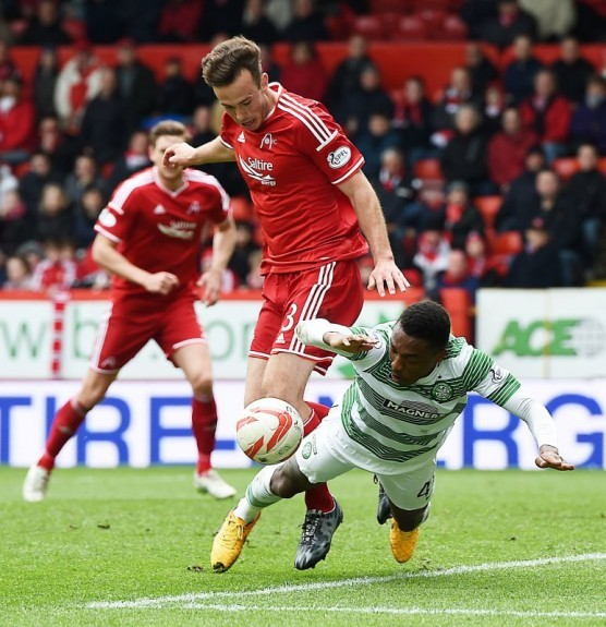 Cries for a penalty can be heard as Aberdeen's Andrew Considine takes down Darnell Fisher (right) in the box