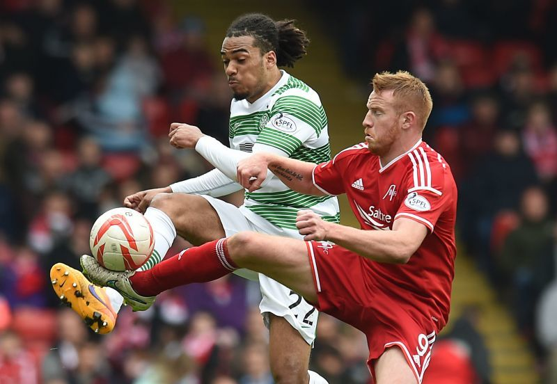 Adam Rooney (right) competes for the loose ball against Celtic's Jason Denayer
