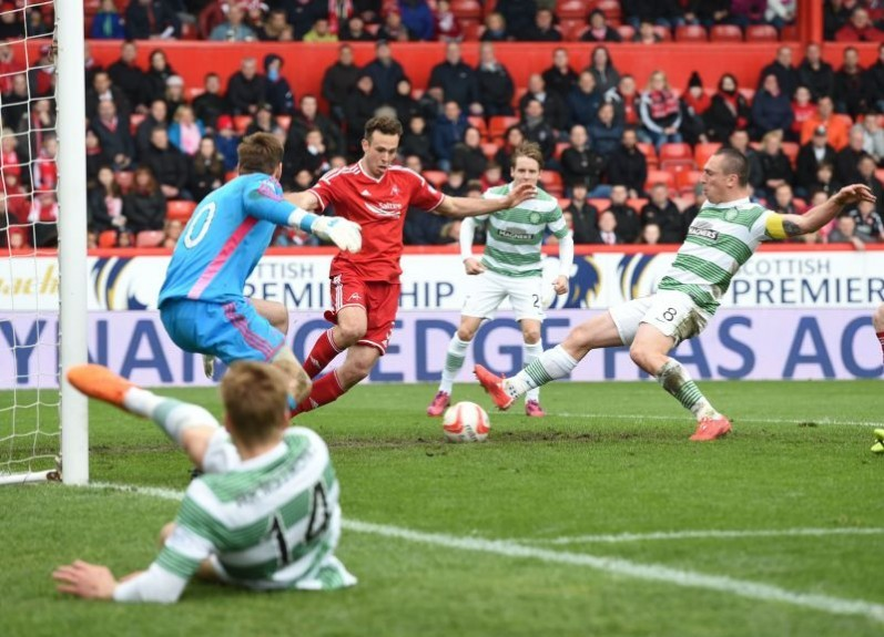 Celtic captain Scott Brown (right) pokes the ball home after great wing-play by team-mate Stuart Armstrong (left)