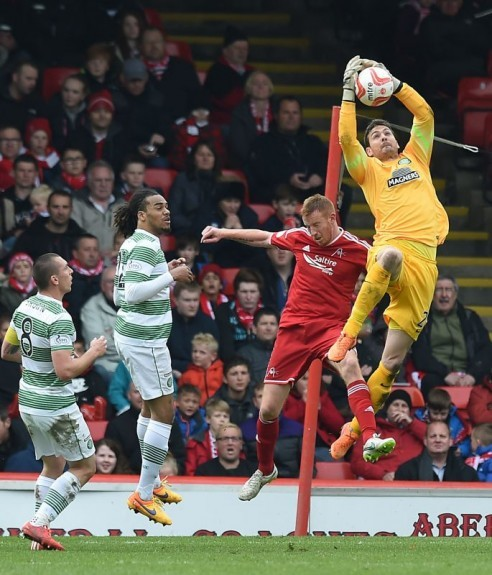 Keeper Craig Gordon (right) gets up well to thwart Aberdeen striker Adam Rooney