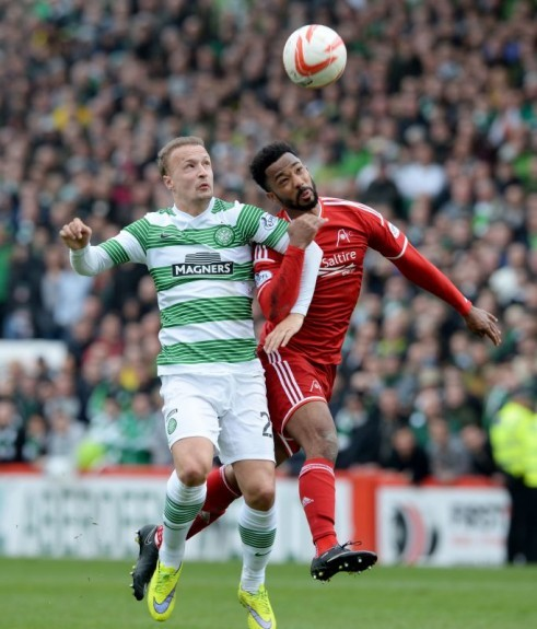 Leigh Griffiths (left) does battle with Aberdeen's Shay Logan