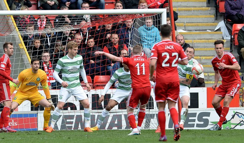 Aberdeen claim for a penalty as the ball appears to hit Celtic's Scott Brown (2nd right) on the arm