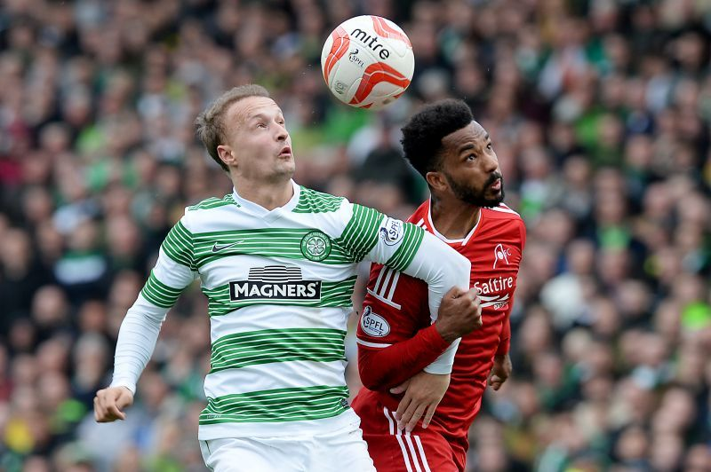 Aberdeen defender Shay Logan is put under pressure by Leigh Griffiths (left)