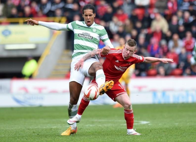 Aberdeen's Jonny Hayes wrestles for possession with Virgil Van Dijk (left)