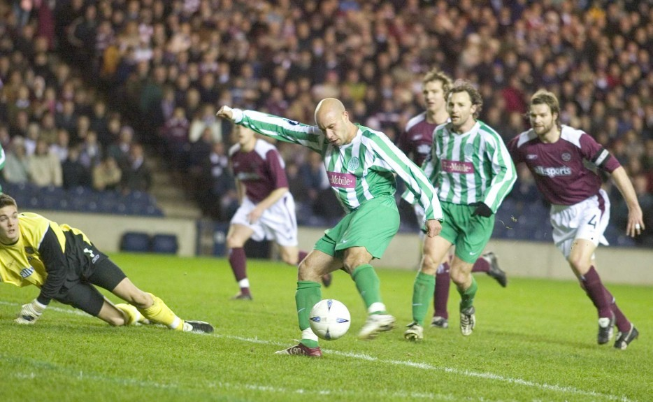 Denes Rosa stabs home the only goal for Ferencvaros against Hearts in the UEFA Cup.