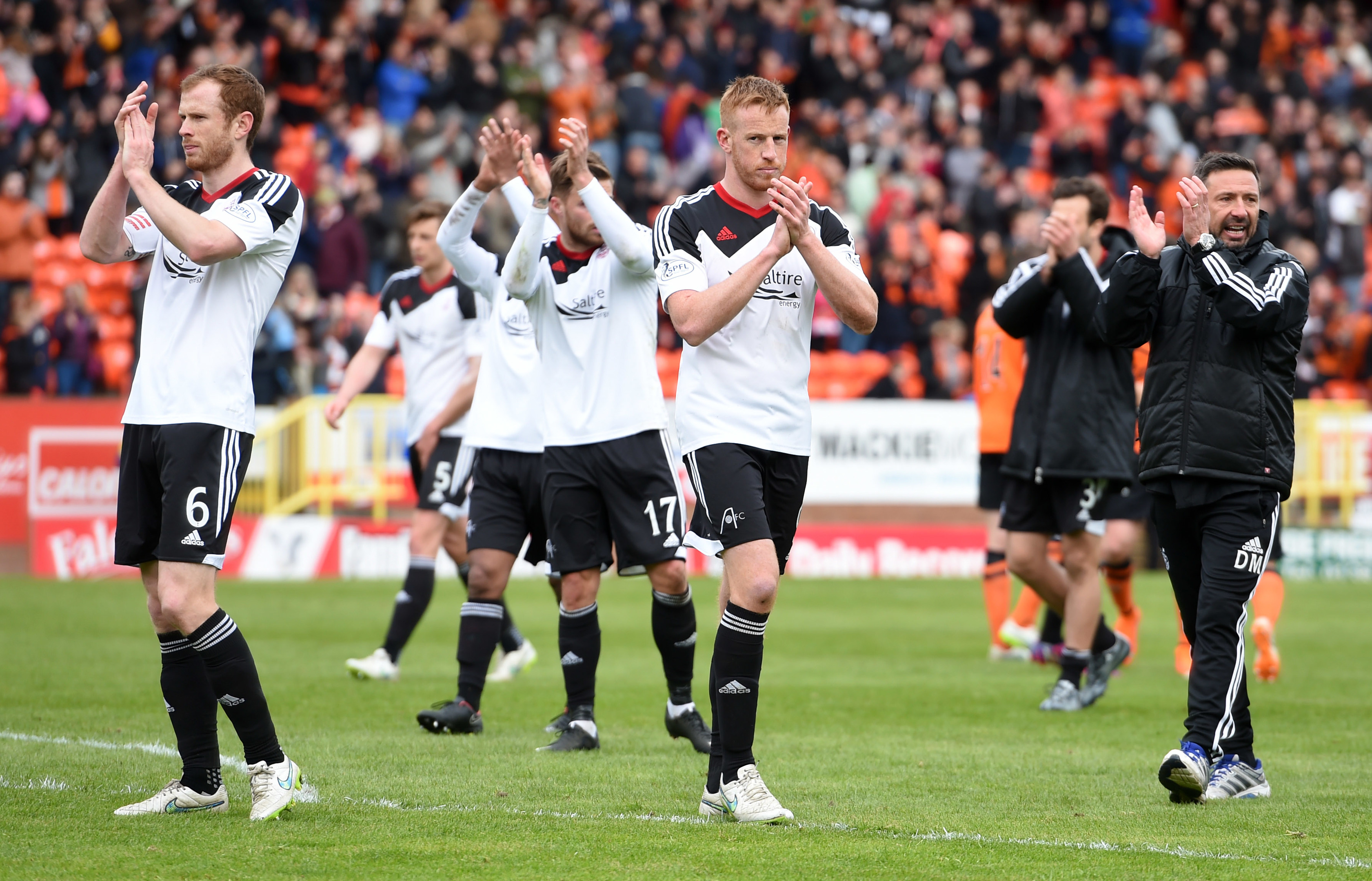 Dons boss Derek McInnes and his players applauded the fans at Tannadice