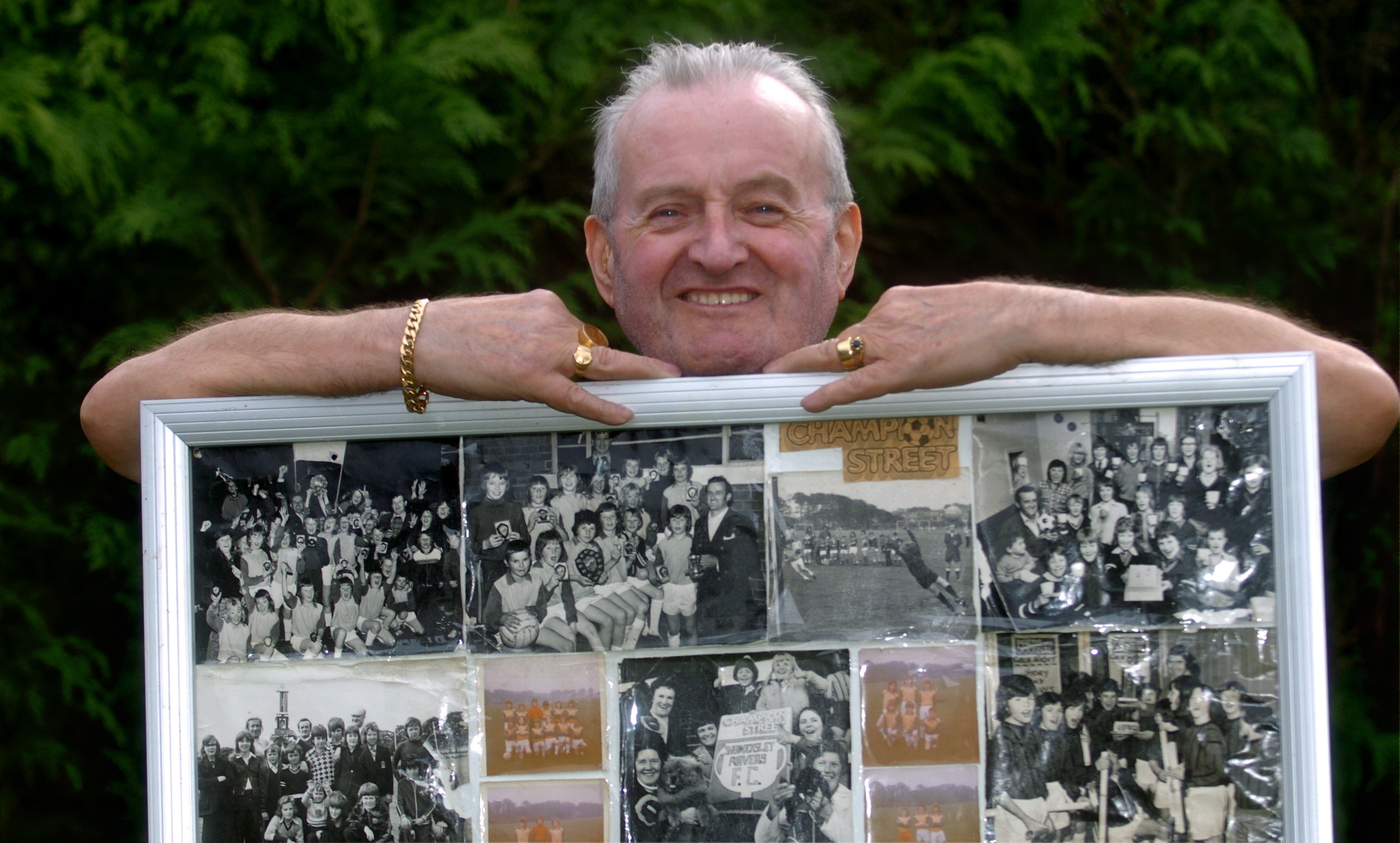 HAPPY MEMORIES:  Stan Buchan with pictures of the team he coached to win the Evening Express-backed Champion Street league.