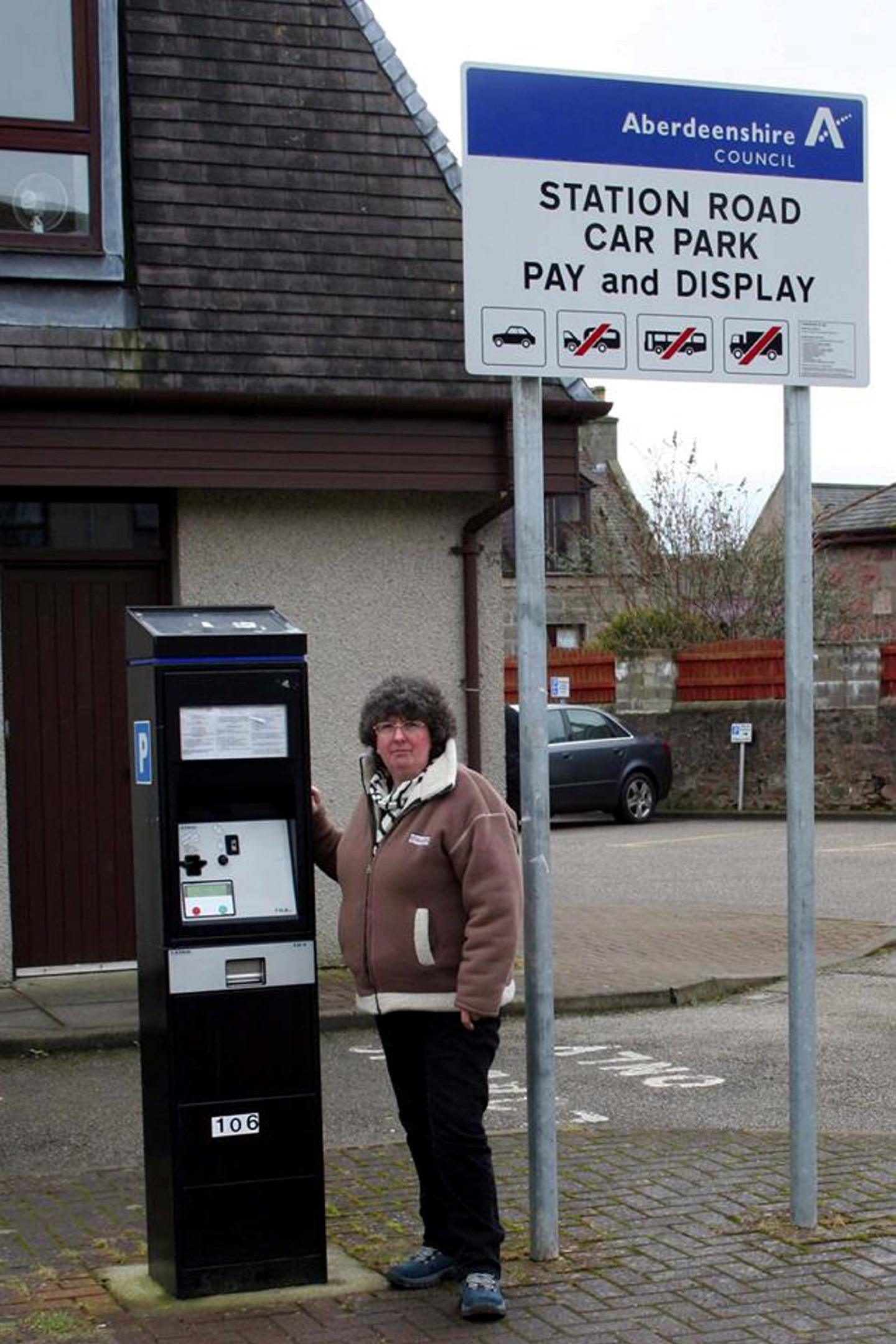 REPLACEMENT DELAY:   Councillor Gillian Owen with one of the old parking meters in Ellon.