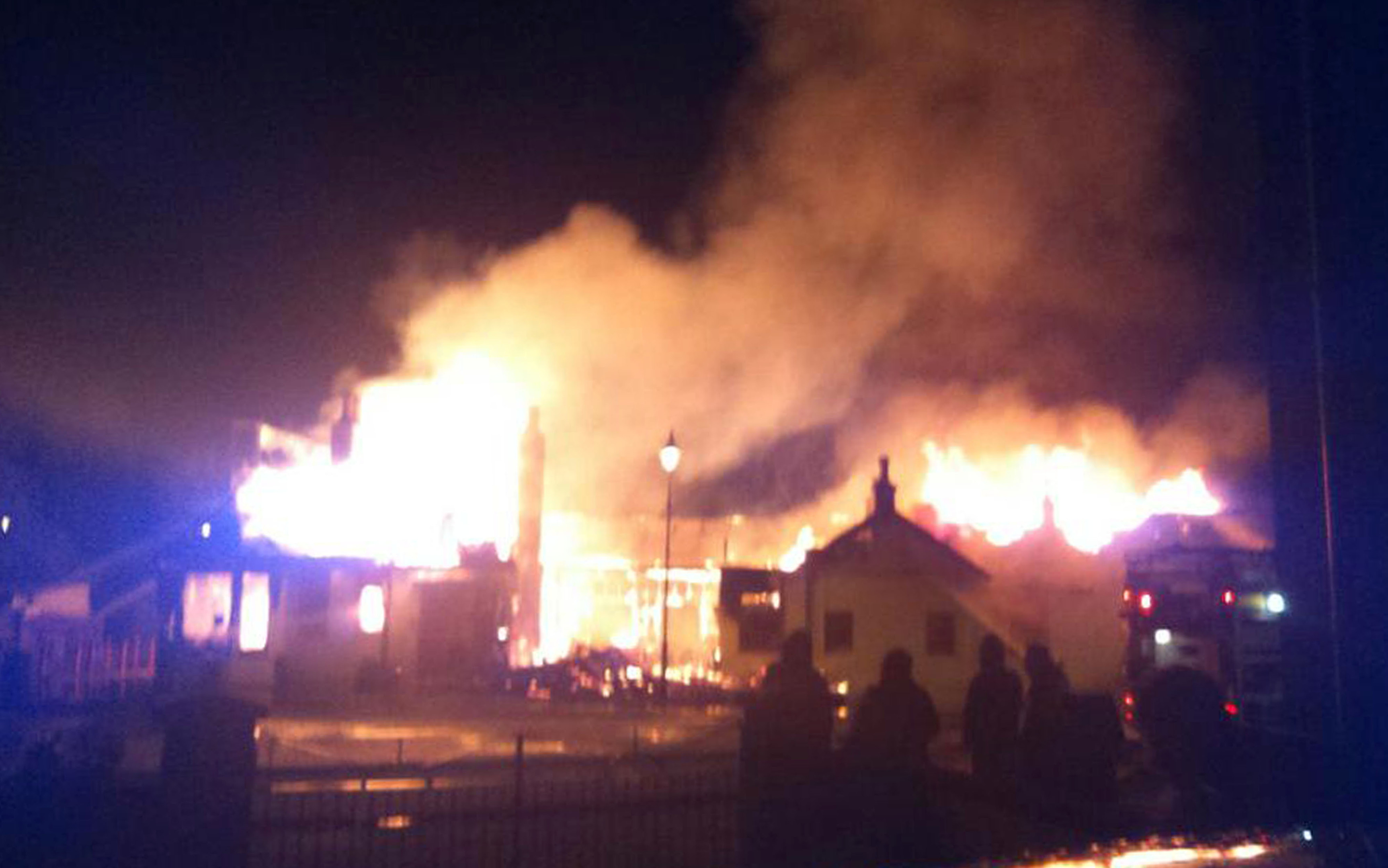 INFERNO: Flames leap from the roof of Ballater's old railway station.