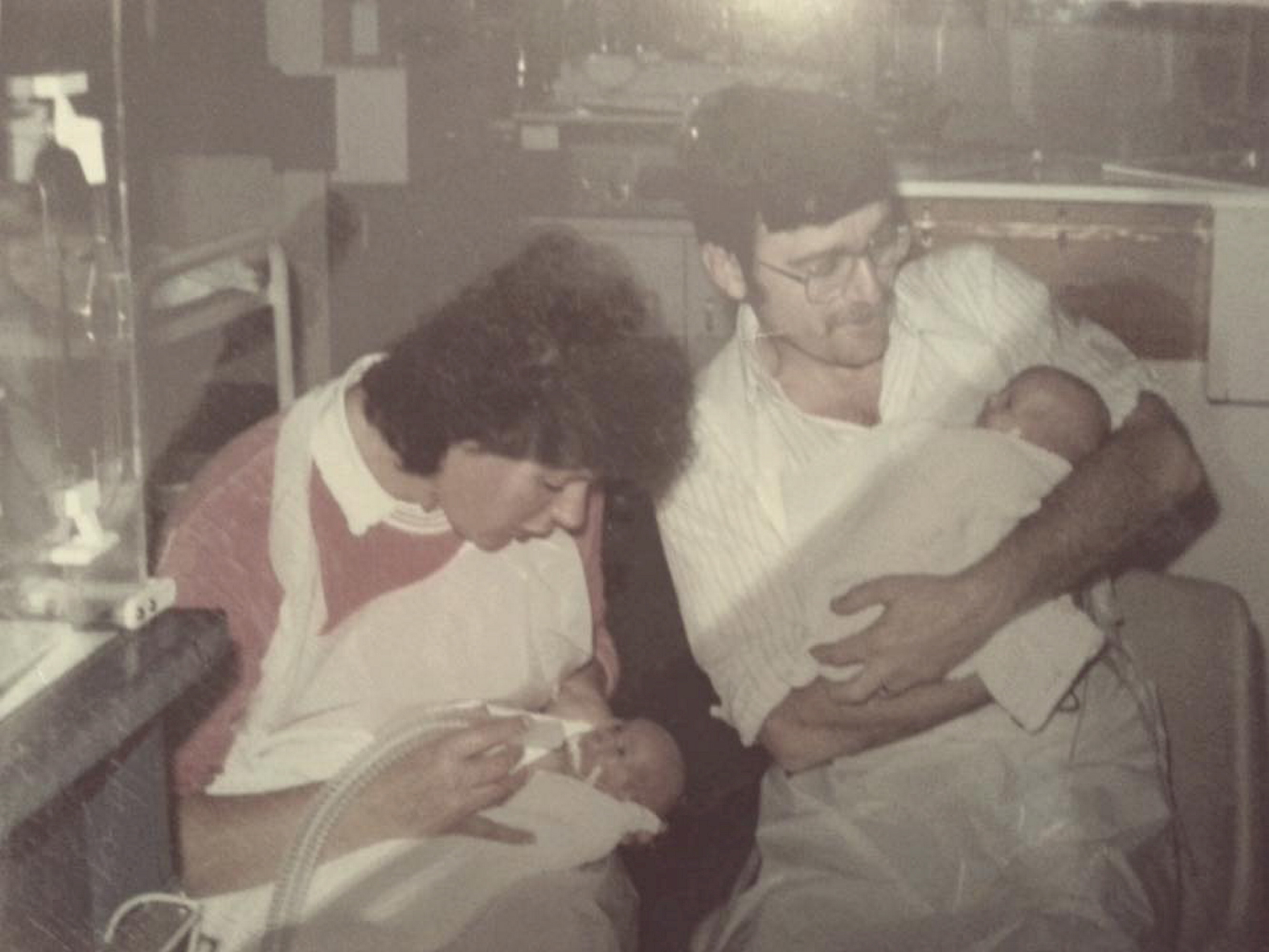 LOVE:  The twins are held by their mum, Pat and dad, Alex after being born prematurely.