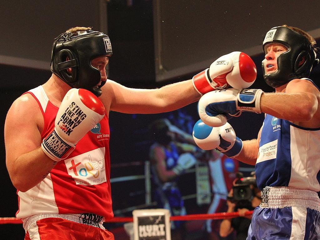 BATTLE:  Mark McKenzie, left, with his opponent in the ring.