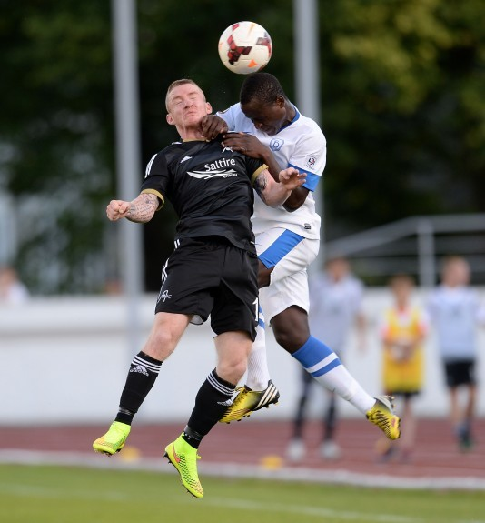 Emmanuel Henry Gomis Mendy (right) challenges Aberdeen's Johnny Hayes for the ball in Riga.