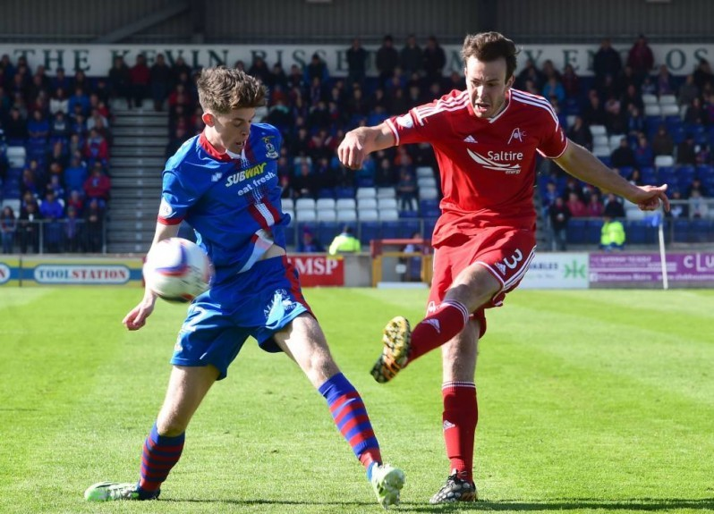 Aberdeen's Andrew Considine (right) clears from ICT's Ryan Christie