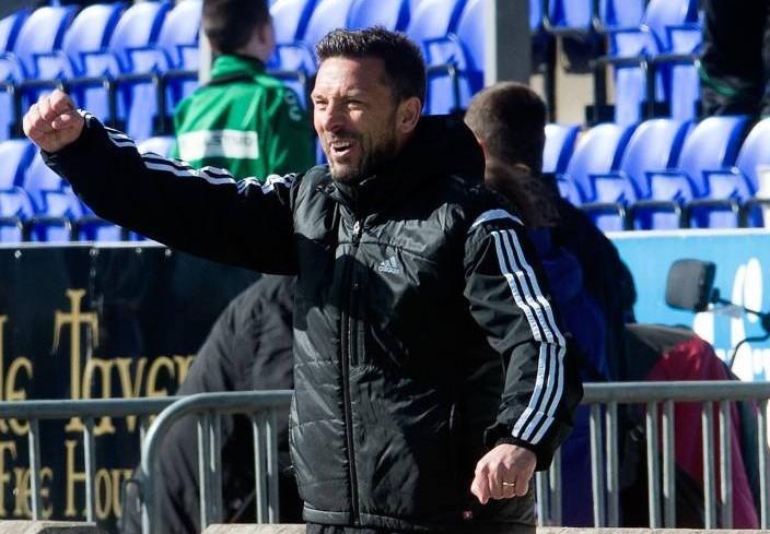 Aberdeen manager Derek McInnes celebrates on the touchline