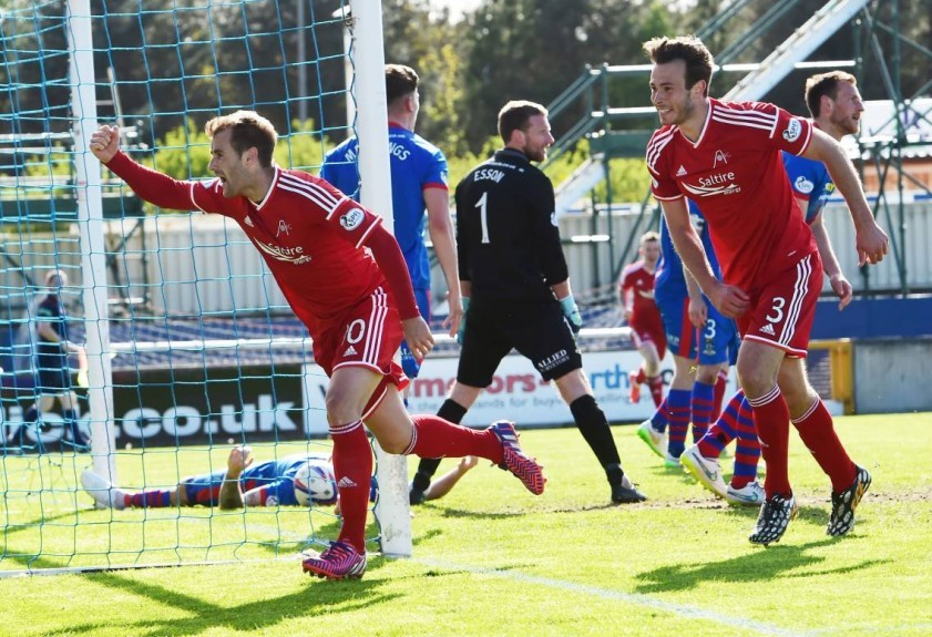 Aberdeen's Niall McGinn (left) wheels away in celebration having hammered the ball home to put his side ahead