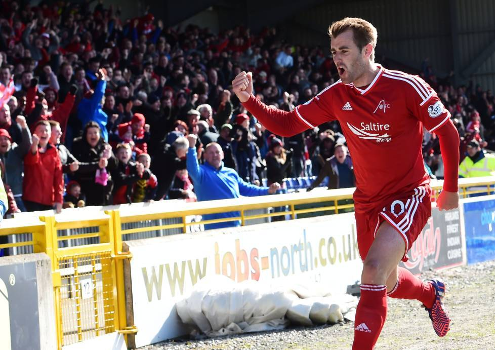 Aberdeen's Niall McGinn wheels away in celebration having hammered the ball home to put his side ahead