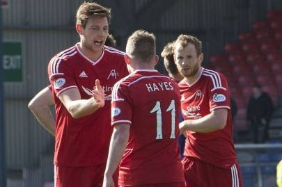 Aberdeen players gather in celebration as they