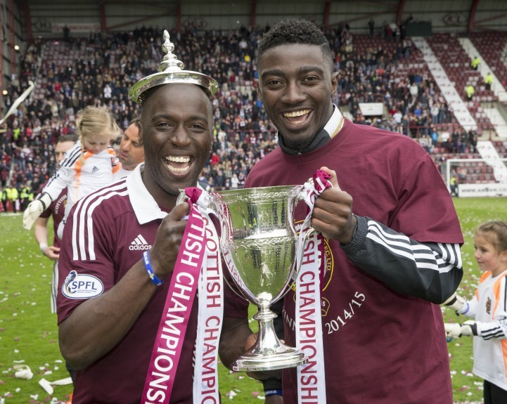 Hearts' Morgaro Gomis (left) and Prince Bauben (right) with the during the Scottish Championship match at Tynecastle Stadium, Edinburgh.