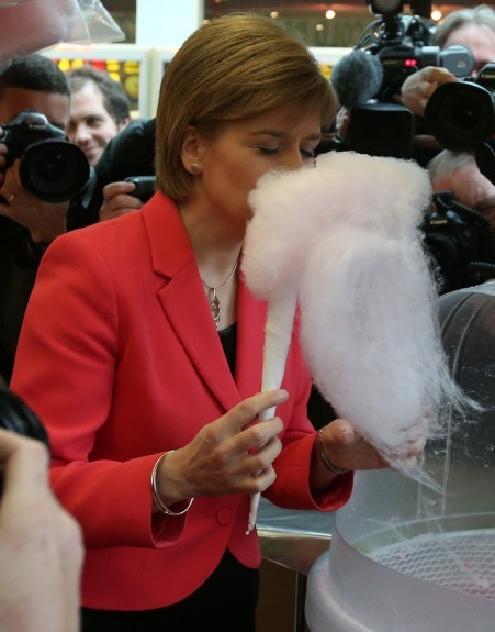 Scotland's First Minister and SNP leader Nicola Sturgeon eats candy floss at Krazy Congo Soft Play at M & D's Theme Park in Motherwell, Scotland, whilst on the General Election campaign trail.