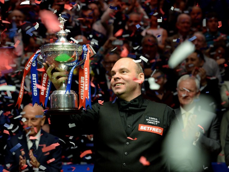Stuart Bingham celebrates with the trophy after winning the final of the Betfred World Championships at the Crucible Theatre, Sheffield.