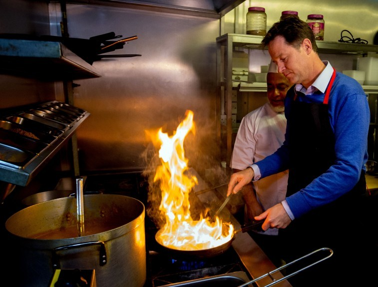 Liberal Democrat leader Nick Clegg making a curry during his visit to the restaurant Dabbawalla in Cardiff while on the General Election campaign trail.